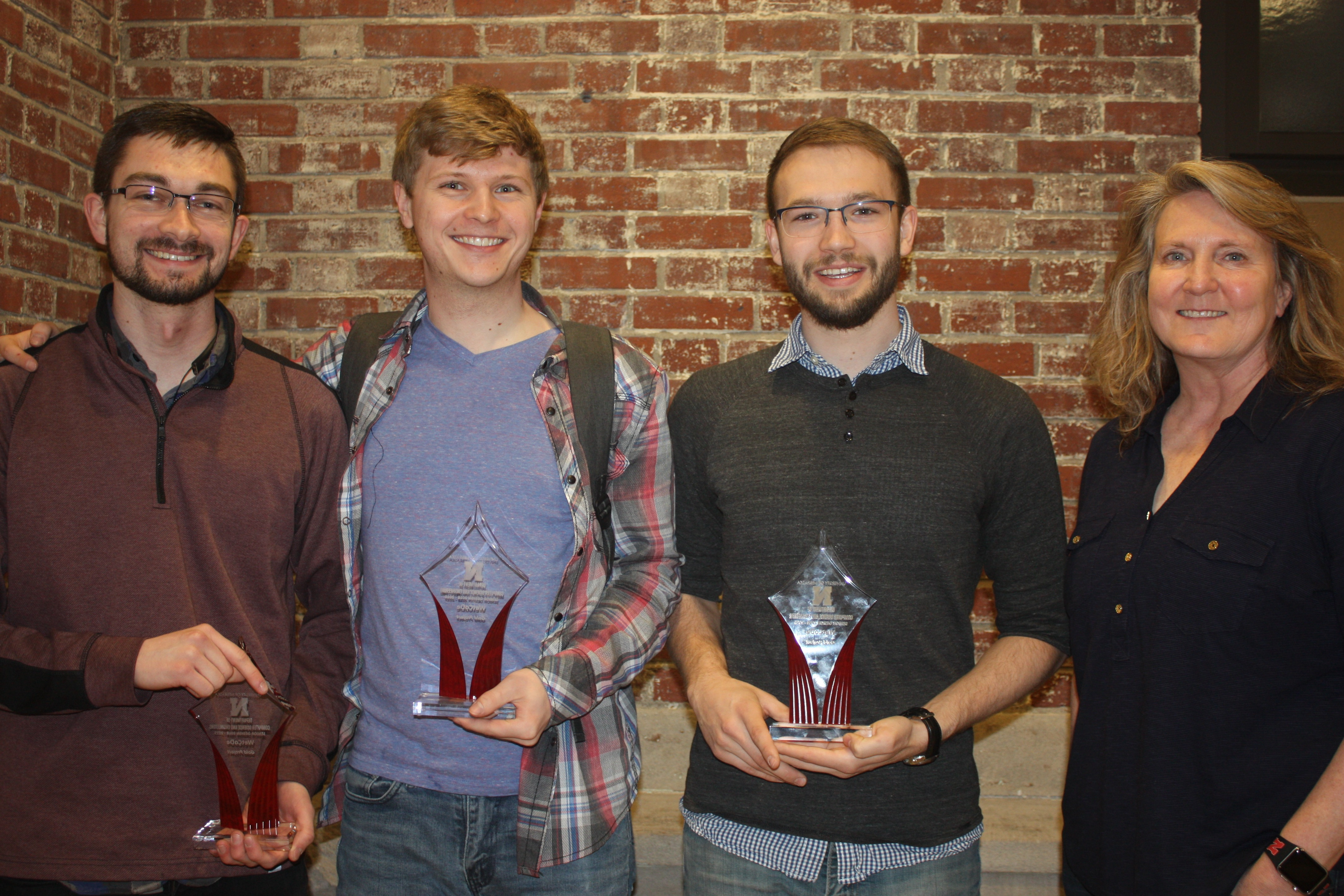 Gold Award team members Tyler Barker, Alex Enersen, and Colton Harper with project manager Melanie Kugler-Wright.