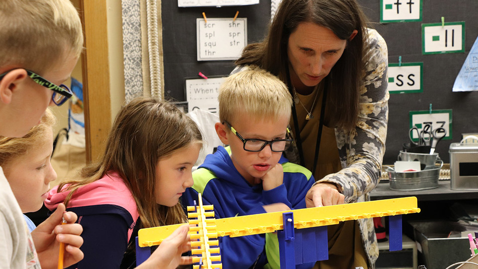 Jennifer Jones, a second-grade teacher at Gretna Elementary School, works with her students on a math lesson. Up to 15 rural Nebraska elementary teachers are being sought to participate in the NebraskaSTEM leadership development program at the University.