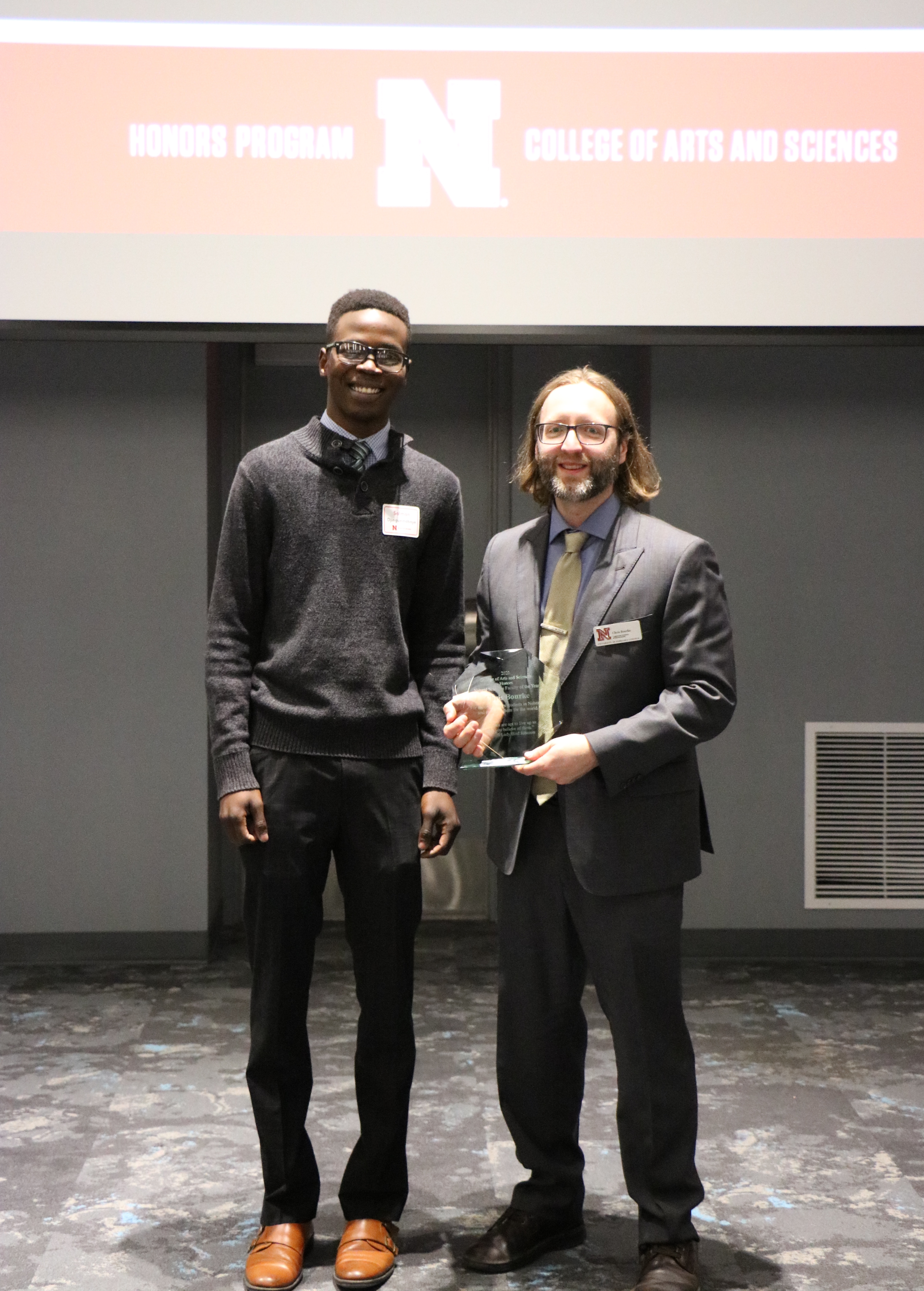Chris Bourke accepting his award at yesterday's CAS Honors ceremony with computer science student speaker Salman Djingueinabaye.