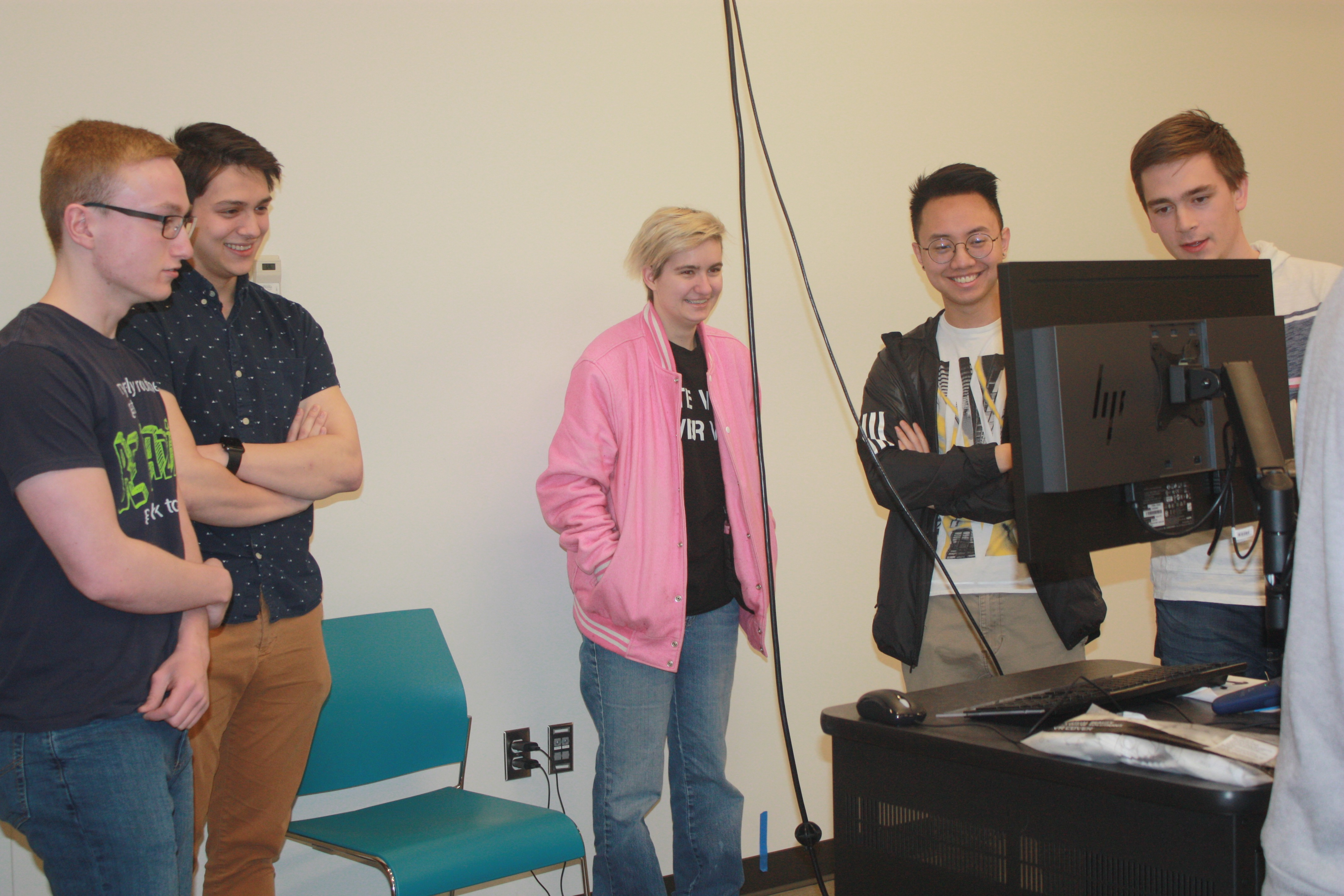 Members of the Platinum Award-winning baldorf team view the VR portion of their project.