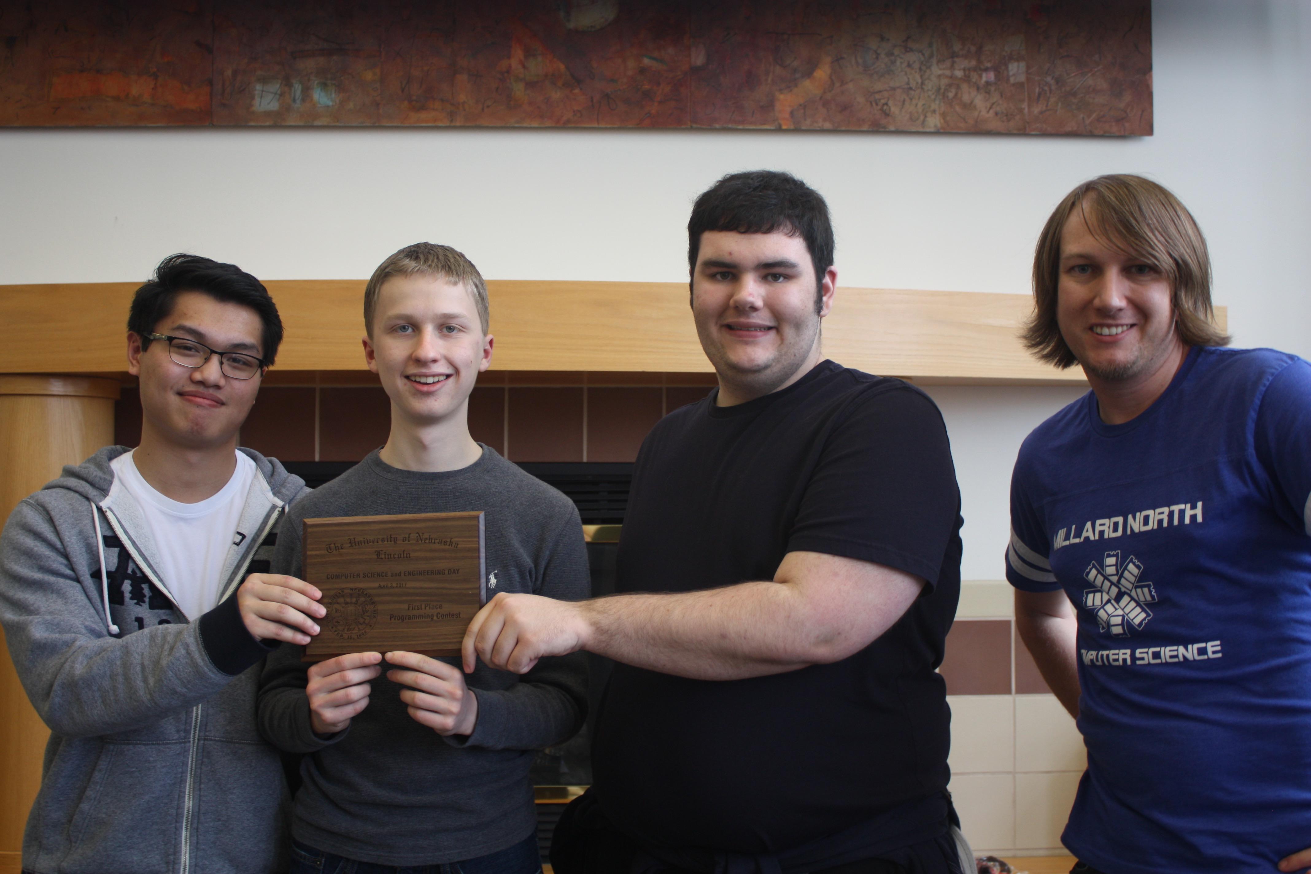 Millard North CSE Day winners Shawn Dong, Zachary Steffek, and Matthew Vavricek with their coach.