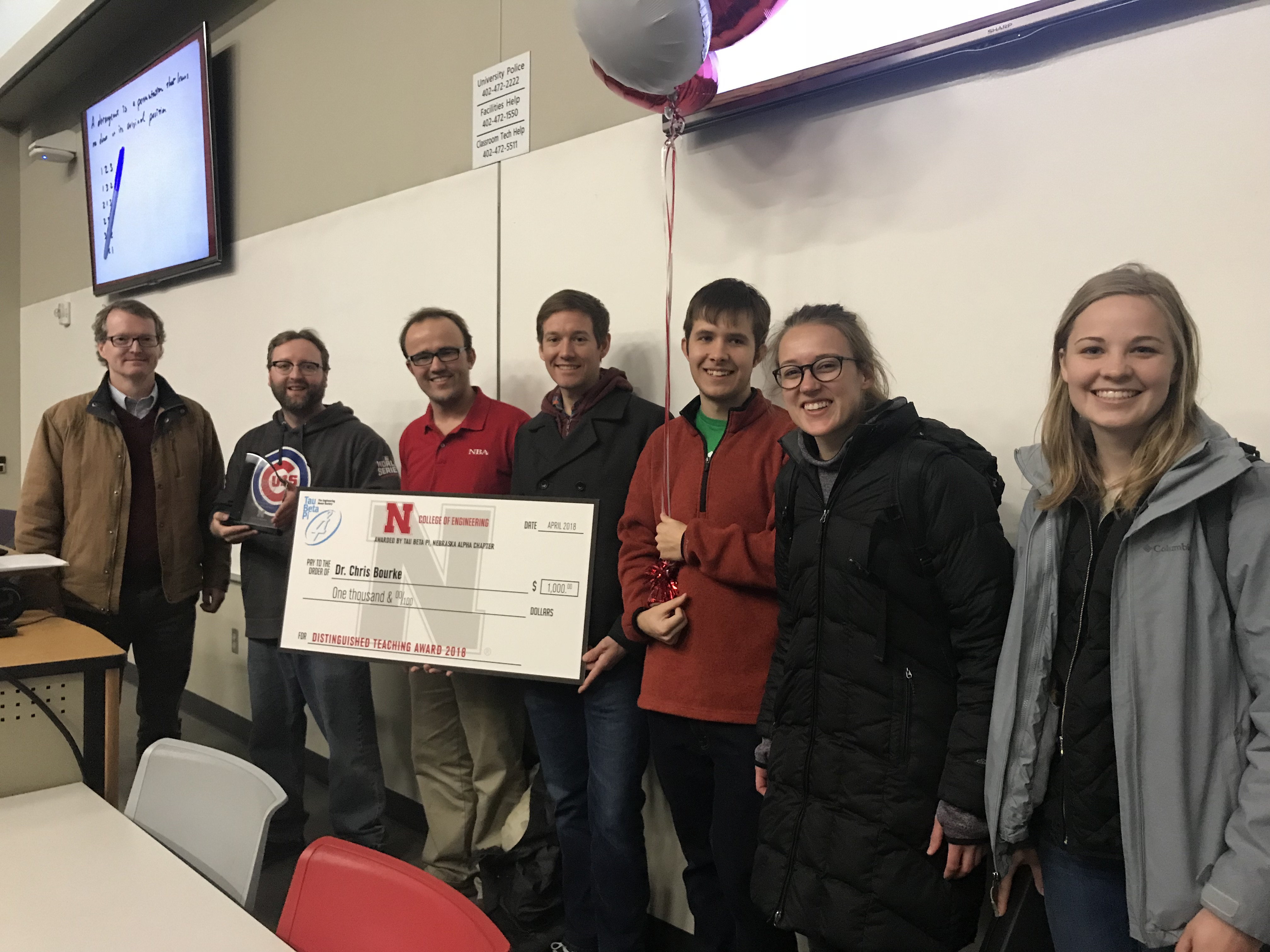 Department chair Matthew Dwyer and members of Tau Beta Pi presenting Chris Bourke with the 2018 Tau Beta Pi Distinguished Teaching Award on Tuesday during class in Brace Hall.