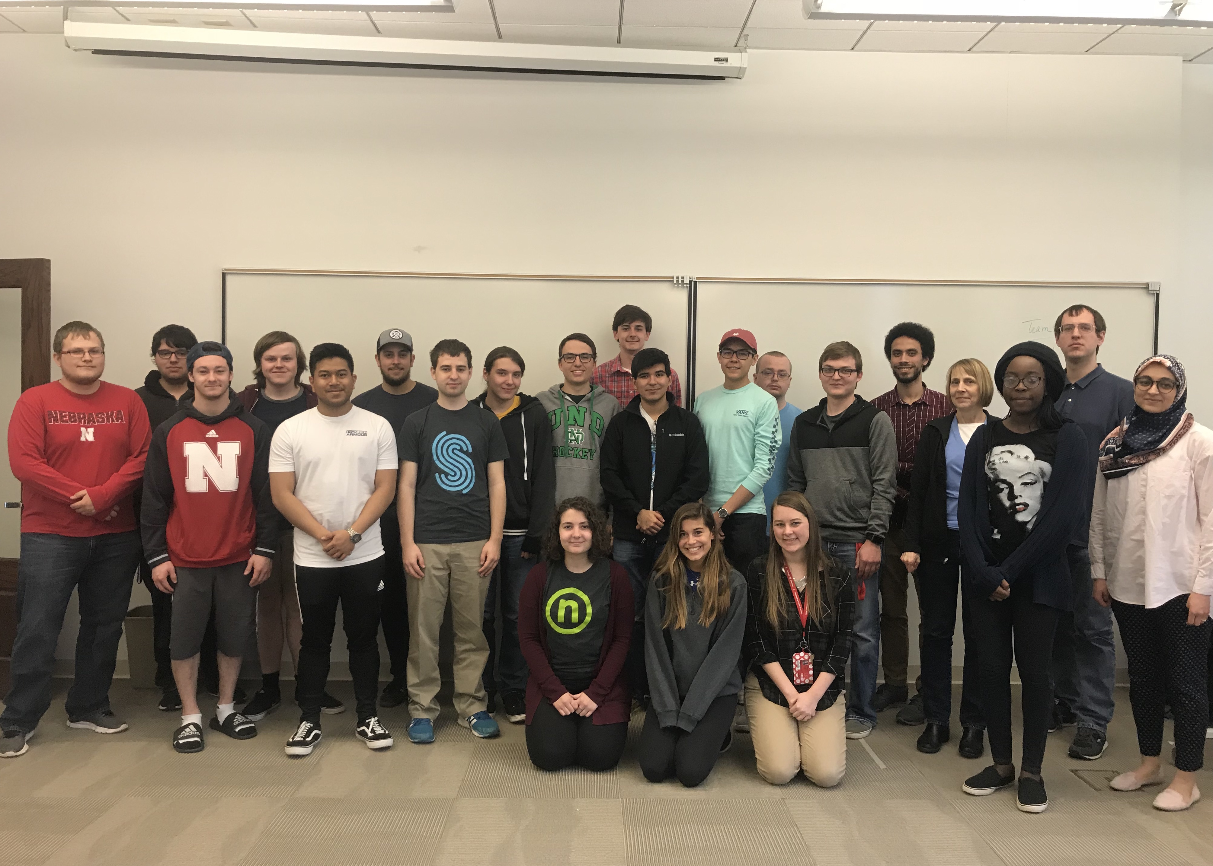 Members of CSE's first software engineering cohort pose after presenting their projects in SOFT 261.