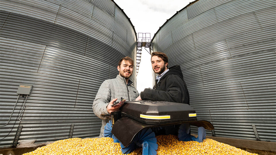 Ben Johnson (left) and Zane Zents recently won a Lemelson-MIT Student Prize for their grain-safety robot, the Grain Weevil.