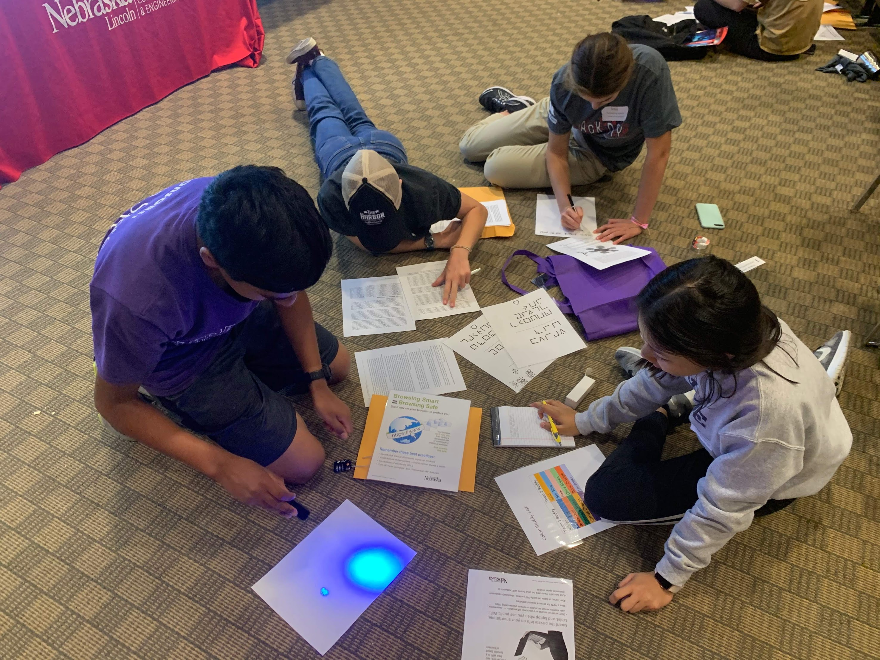 Students at CSE Hack Day participate in an Escape Room Challenge activity.