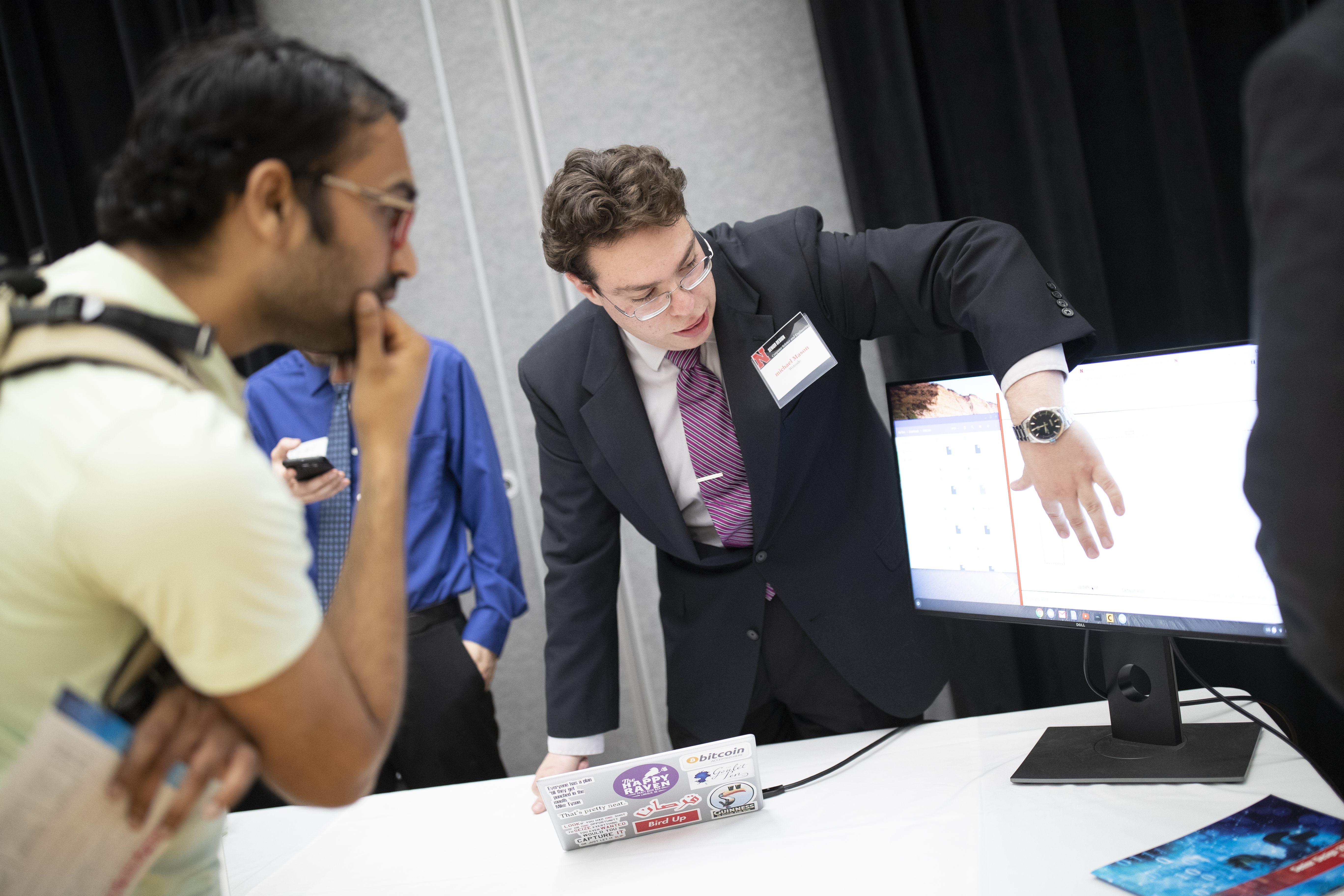 A student presents a project at the 2019 Senior Design Showcase.