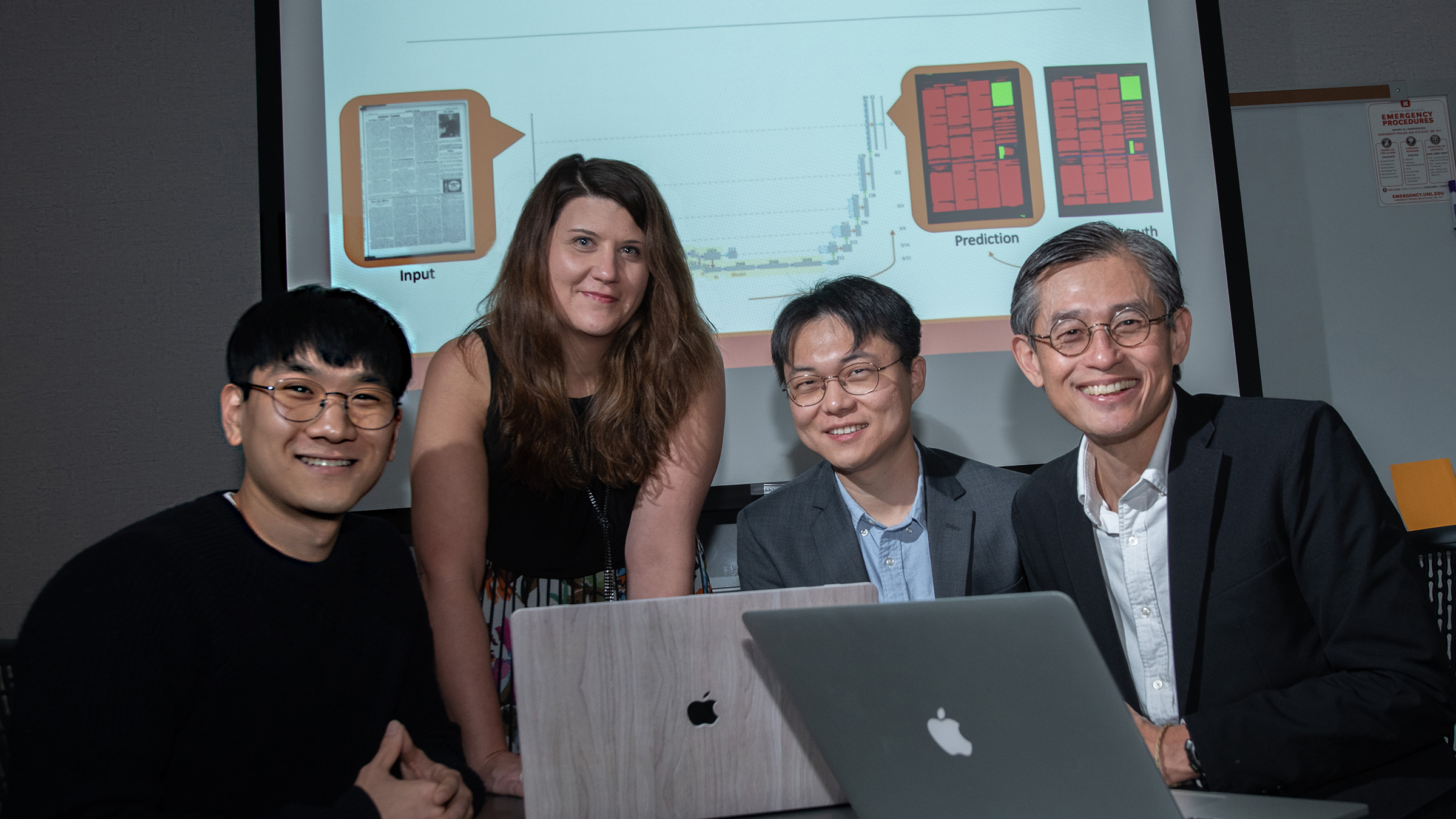 Members of the Aida lab (from left) Chulwood Pack, graduate student; Elizabeth Lorang, associate professor in University Libraries; Yi Liu, graduate student; and Leen-Kiat Soh, professor of computer science and engineering, recently completed research on using machine learning in digital libraries for the United States Library of Congress.